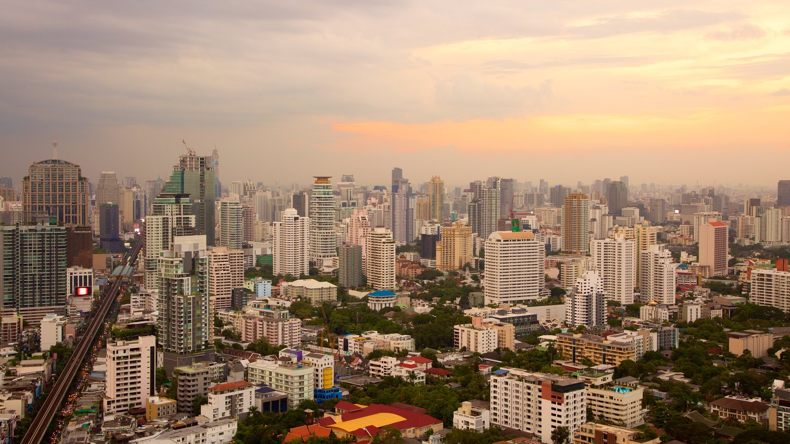 Sukhumvit which includes a sunset and a city