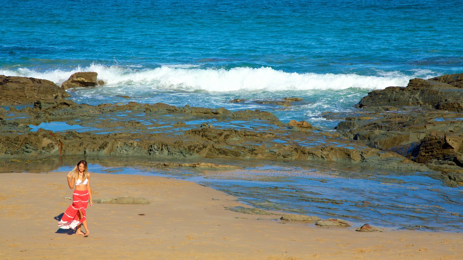 Lorne which includes rugged coastline as well as an individual femail
