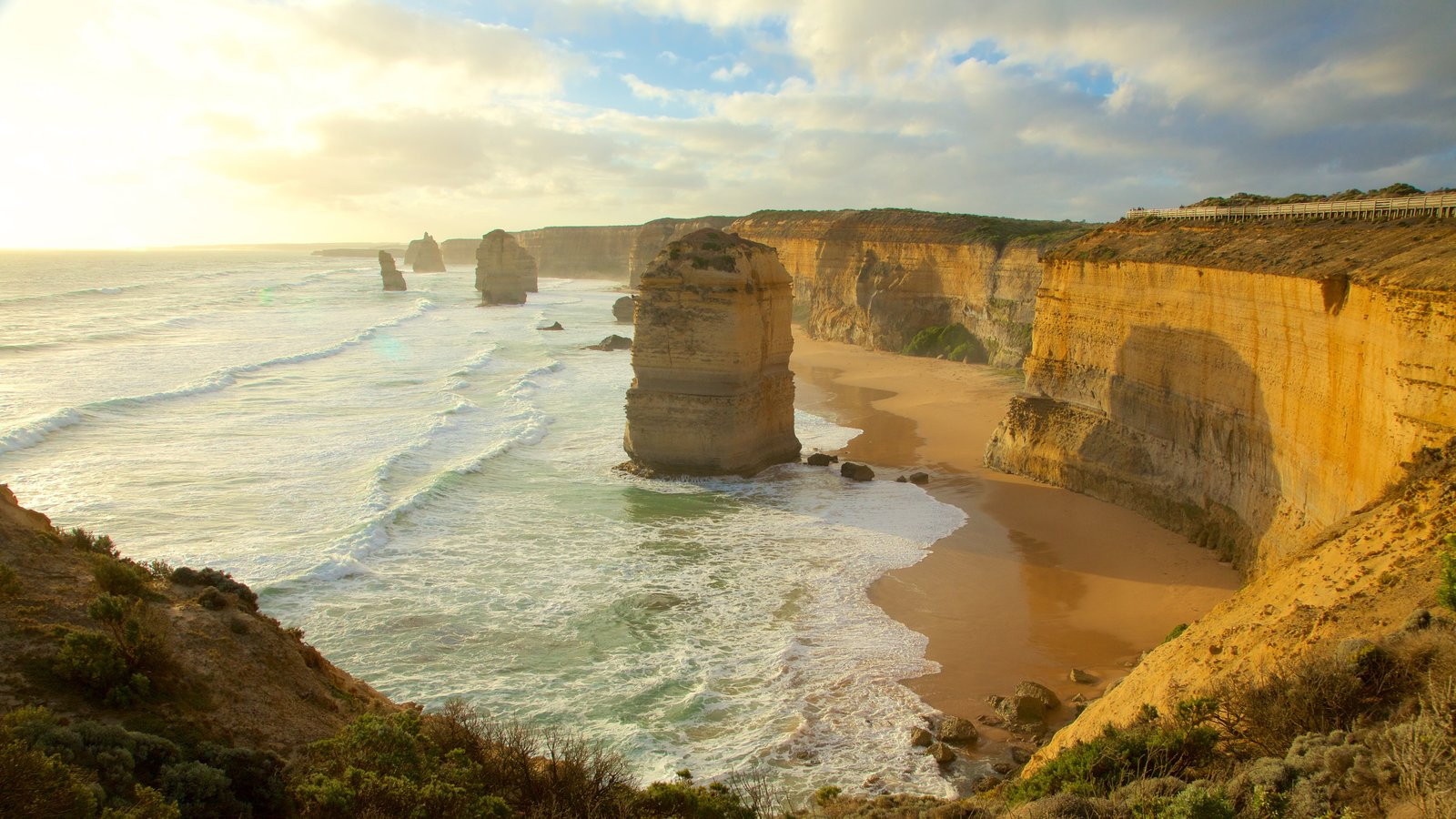 Twelve Apostles featuring a gorge or canyon, a sunset and rocky coastline