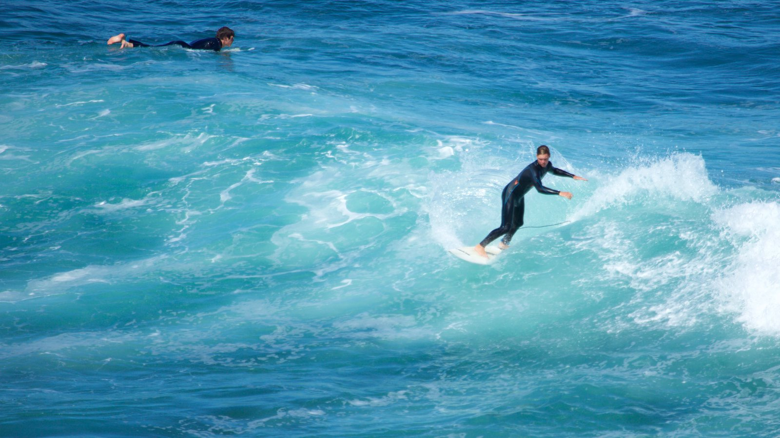 Bell\'s Beach featuring surfing and waves as well as an individual male