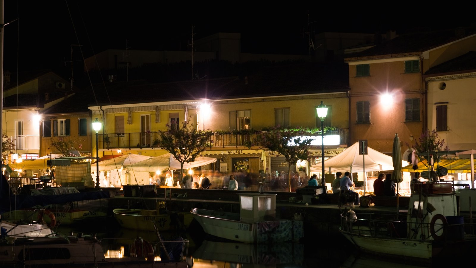 Cervia showing a marina, night scenes and outdoor eating