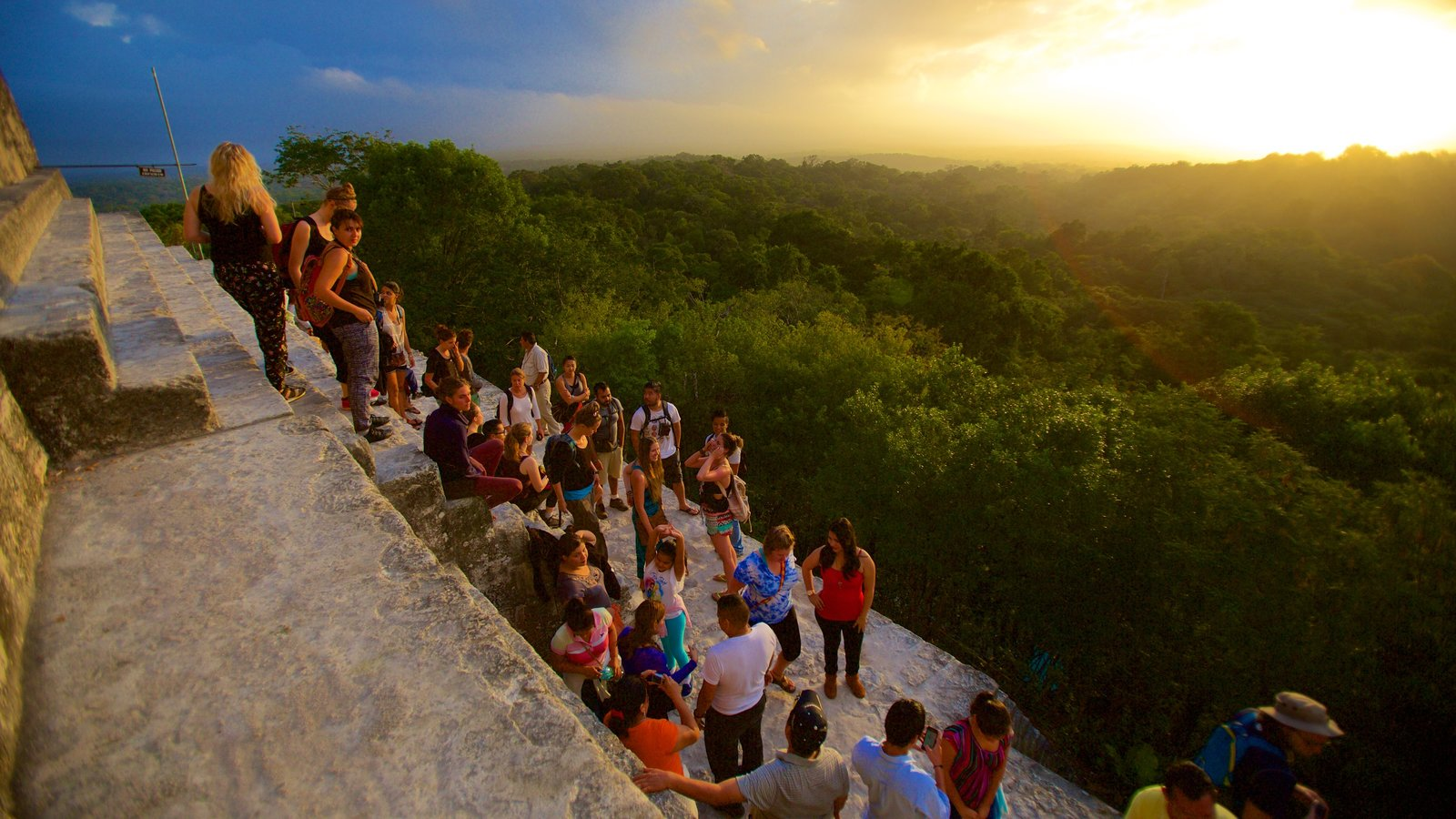 Tikal which includes a sunset, forest scenes and tranquil scenes