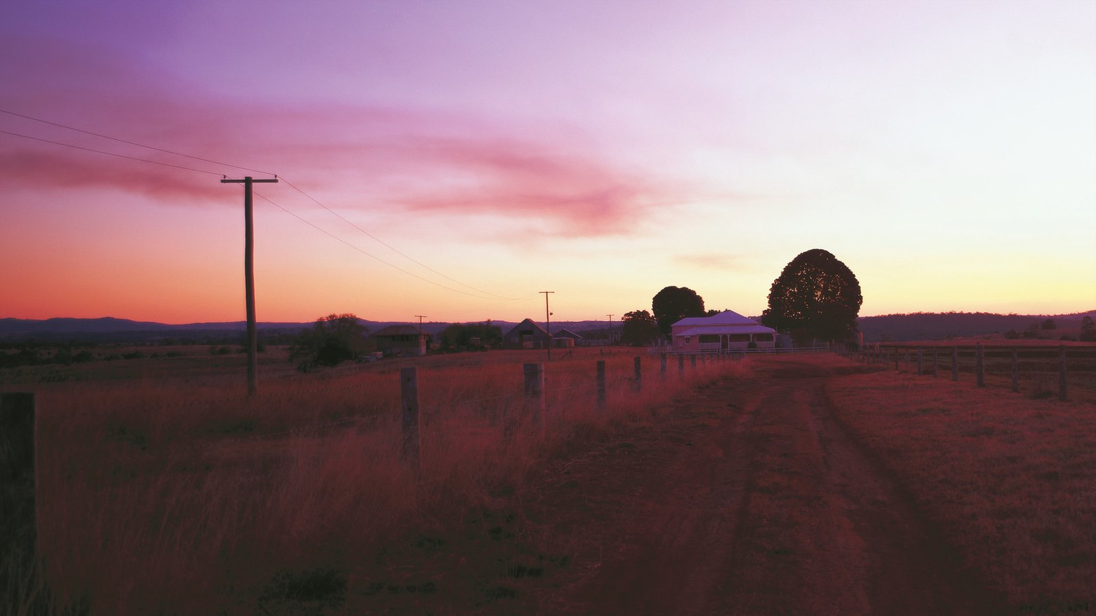 Darling Downs showing farmland and a sunset
