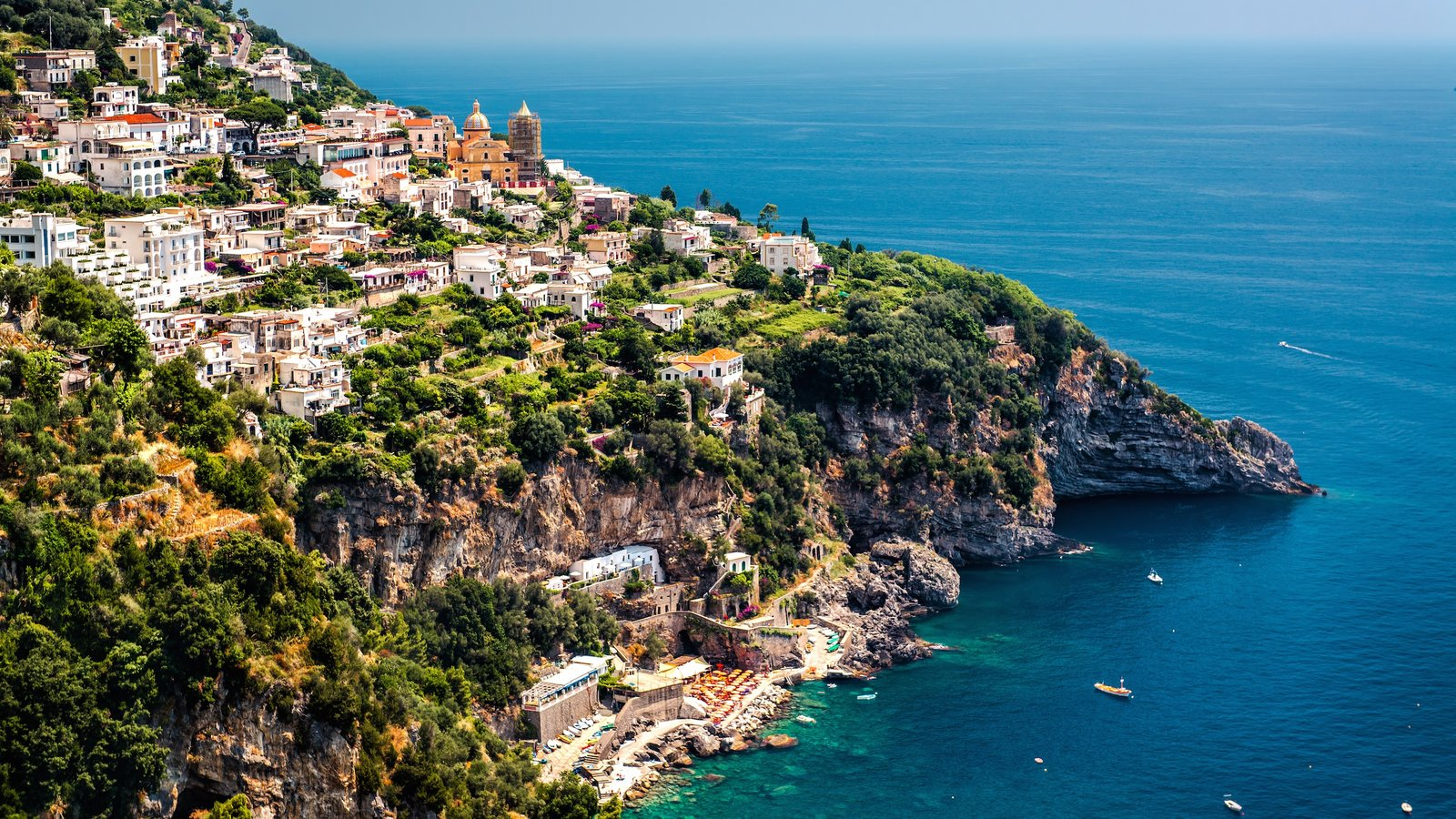 Salerno showing a coastal town and rocky coastline