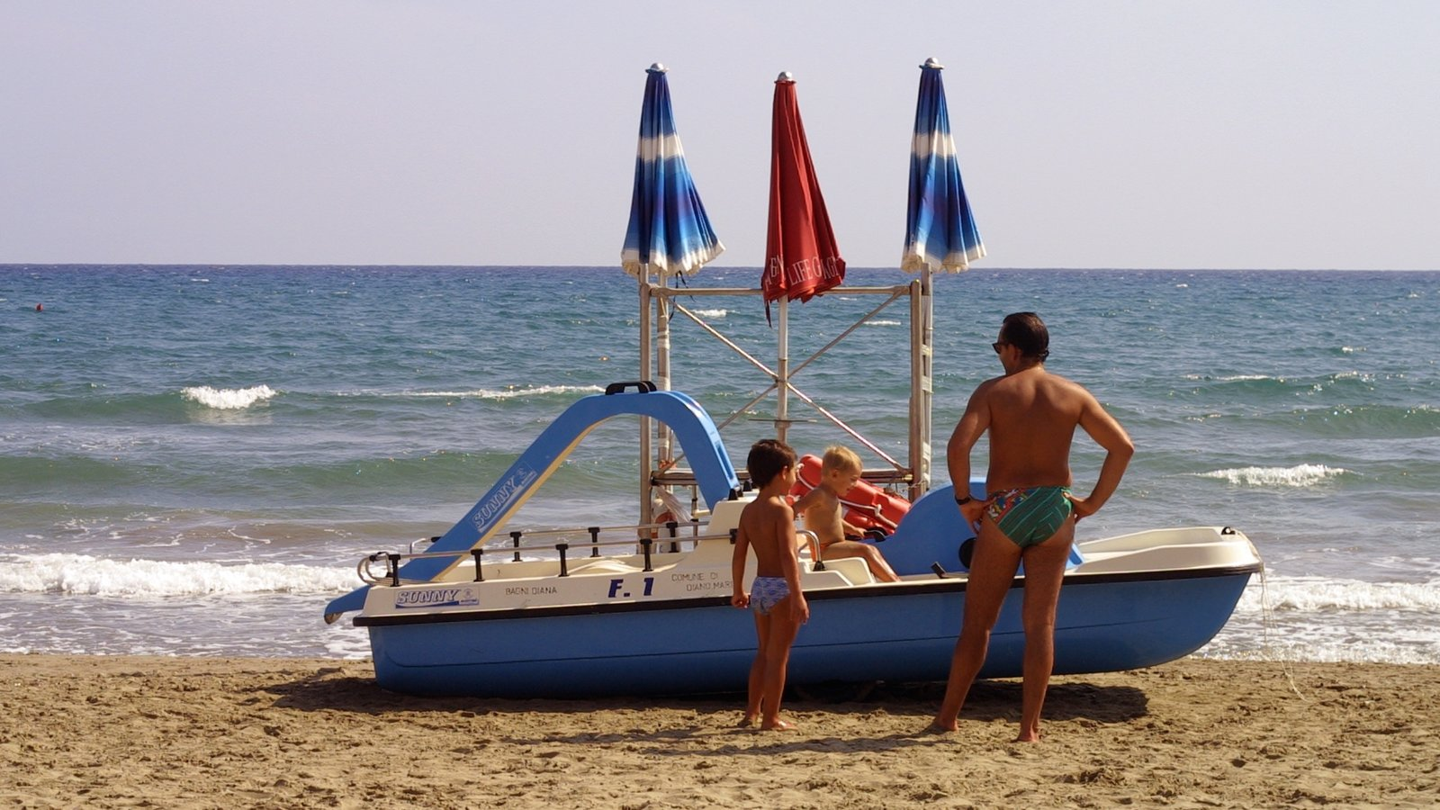Diano Marina featuring a beach as well as a family