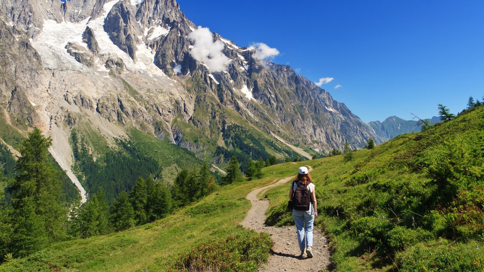 Aosta featuring mountains and hiking or walking as well as an individual child