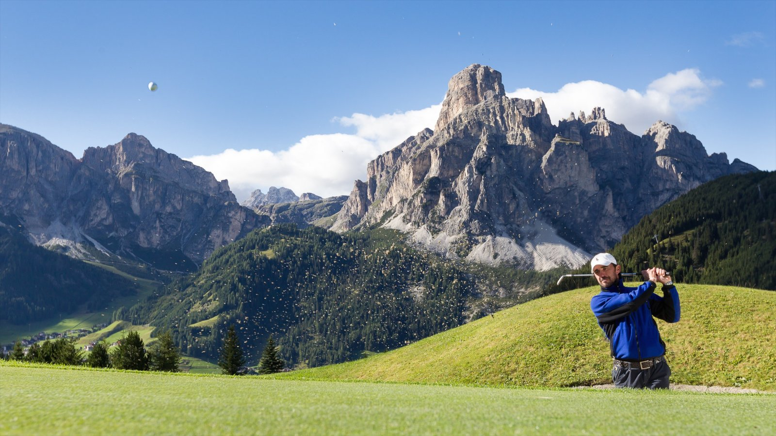 Alta Badia featuring golf and mountains as well as an individual male