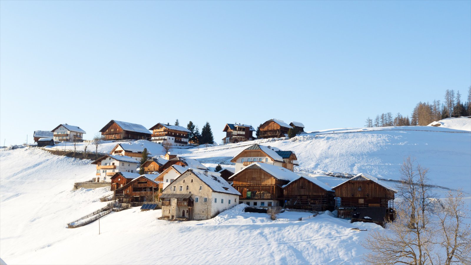 Alta Badia which includes a small town or village and snow