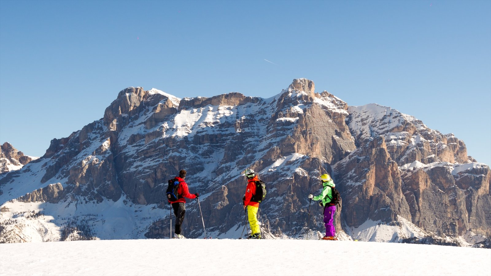 Alta Badia showing snow and mountains as well as a small group of people