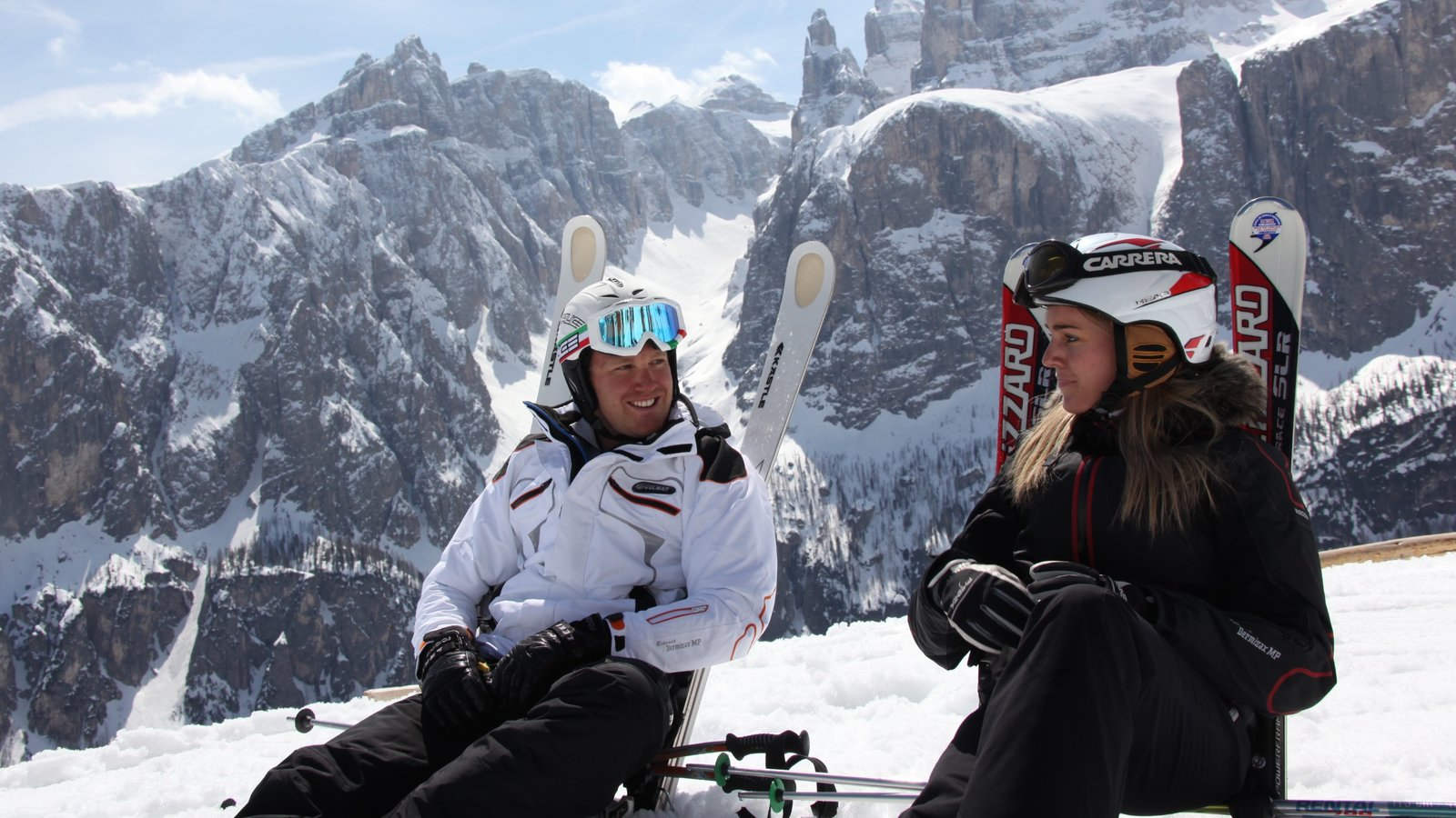 Alta Badia which includes snow skiing and snow as well as a small group of people