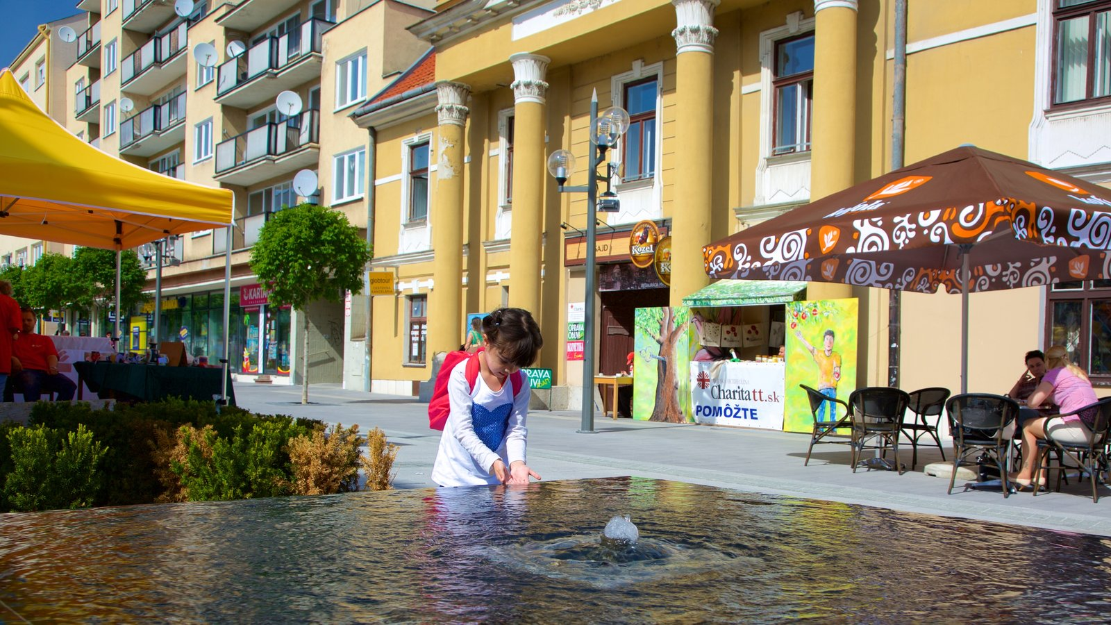 Trnava featuring a fountain as well as an individual child