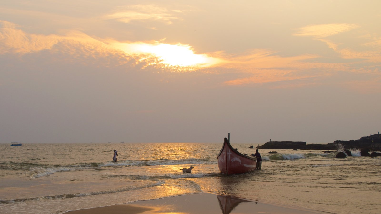 Baga Beach which includes boating, a sandy beach and a sunset