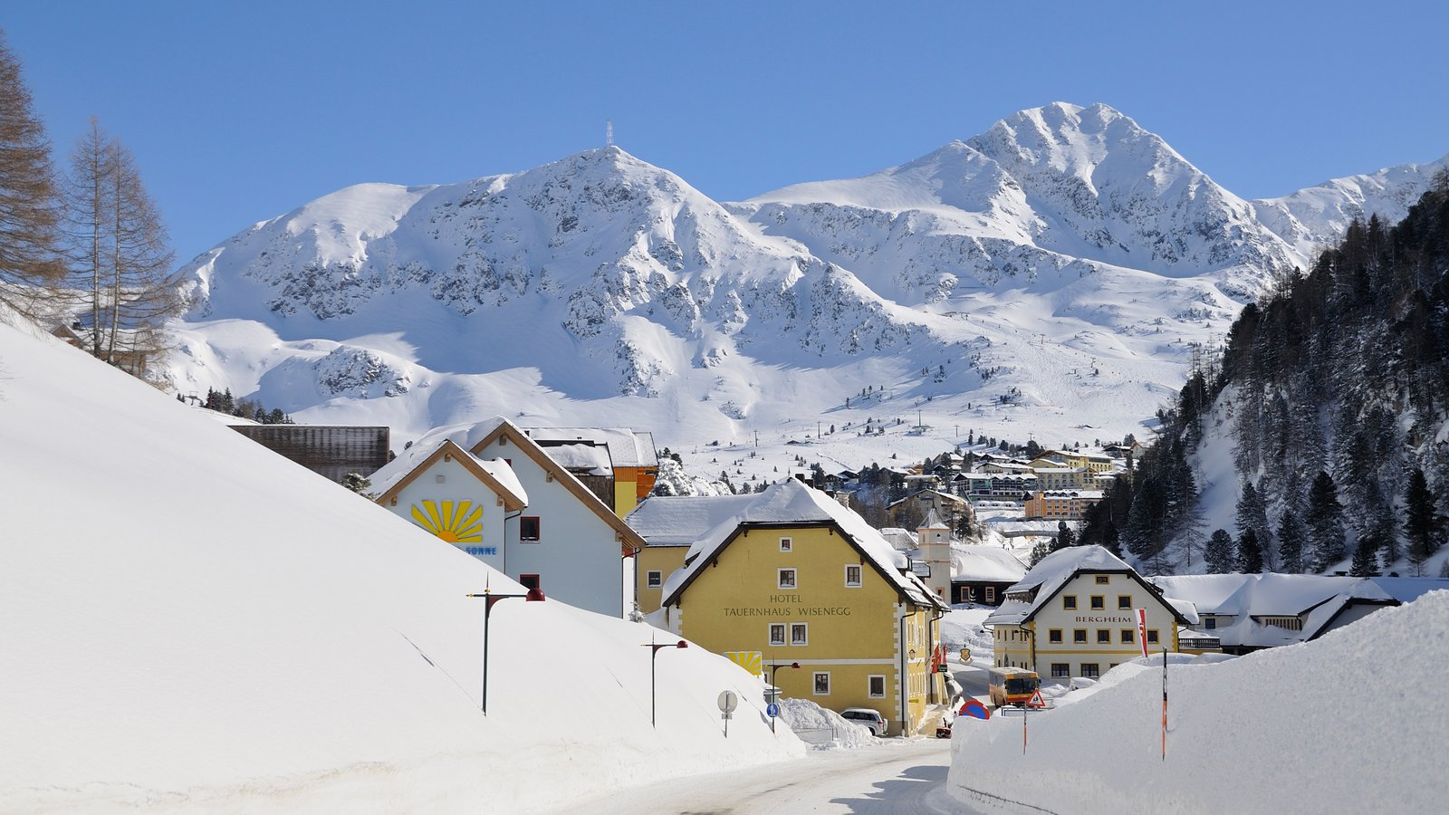 Obertauern featuring mountains, a small town or village and snow