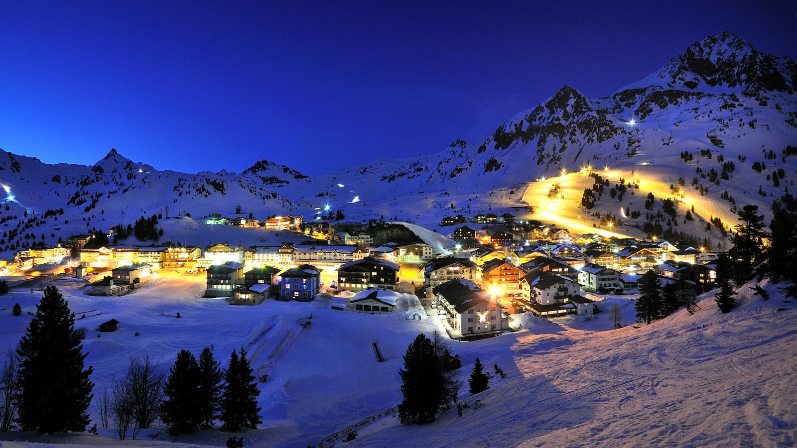 Obertauern featuring a small town or village, night scenes and snow