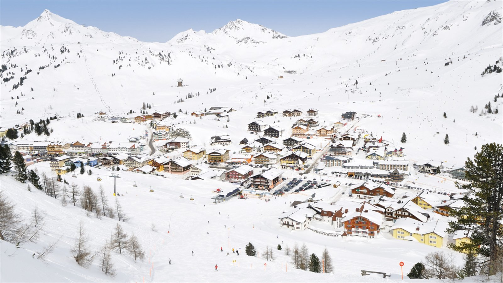 Obertauern featuring a small town or village, mountains and snow