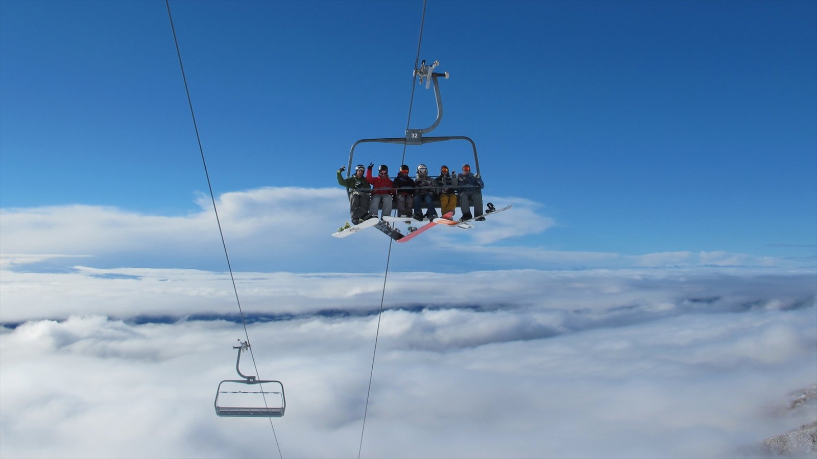 Treble Cone featuring a gondola as well as a small group of people