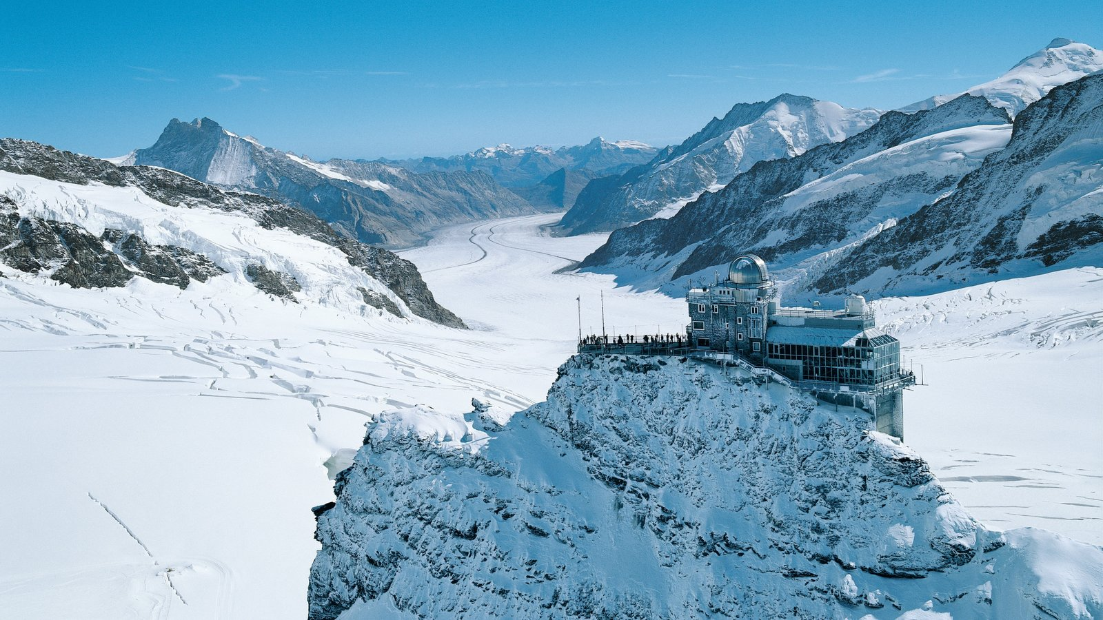 Jungfraujoch featuring an observatory, snow and mountains