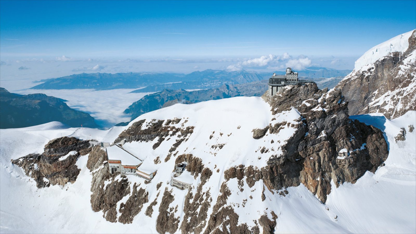 Jungfraujoch showing mountains, snow and an observatory