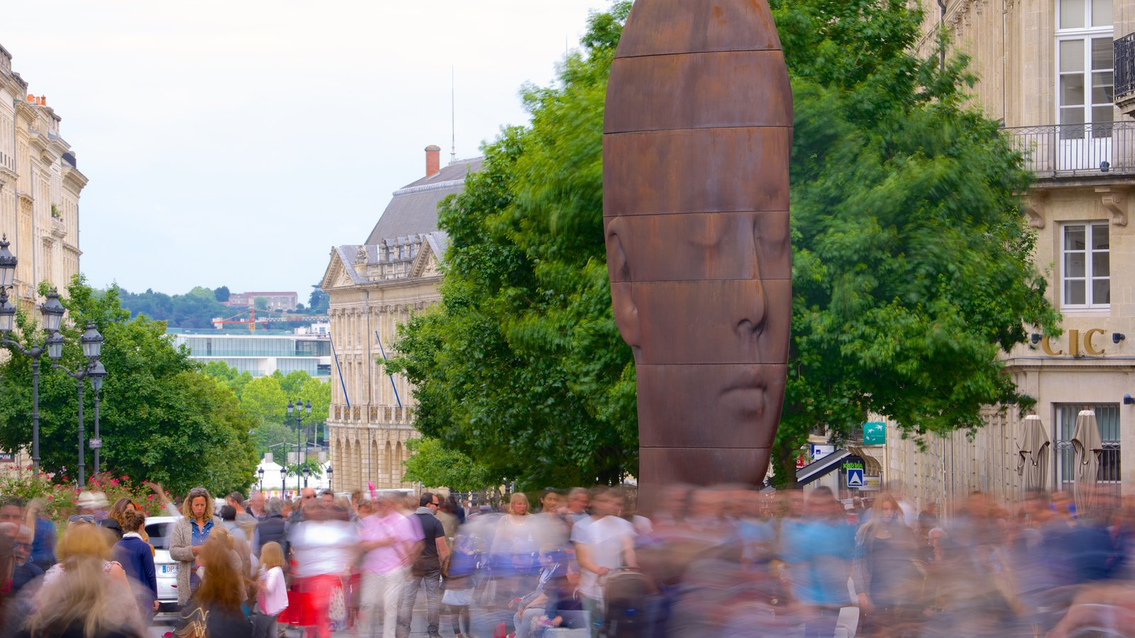 Bordeaux which includes outdoor art as well as a large group of people