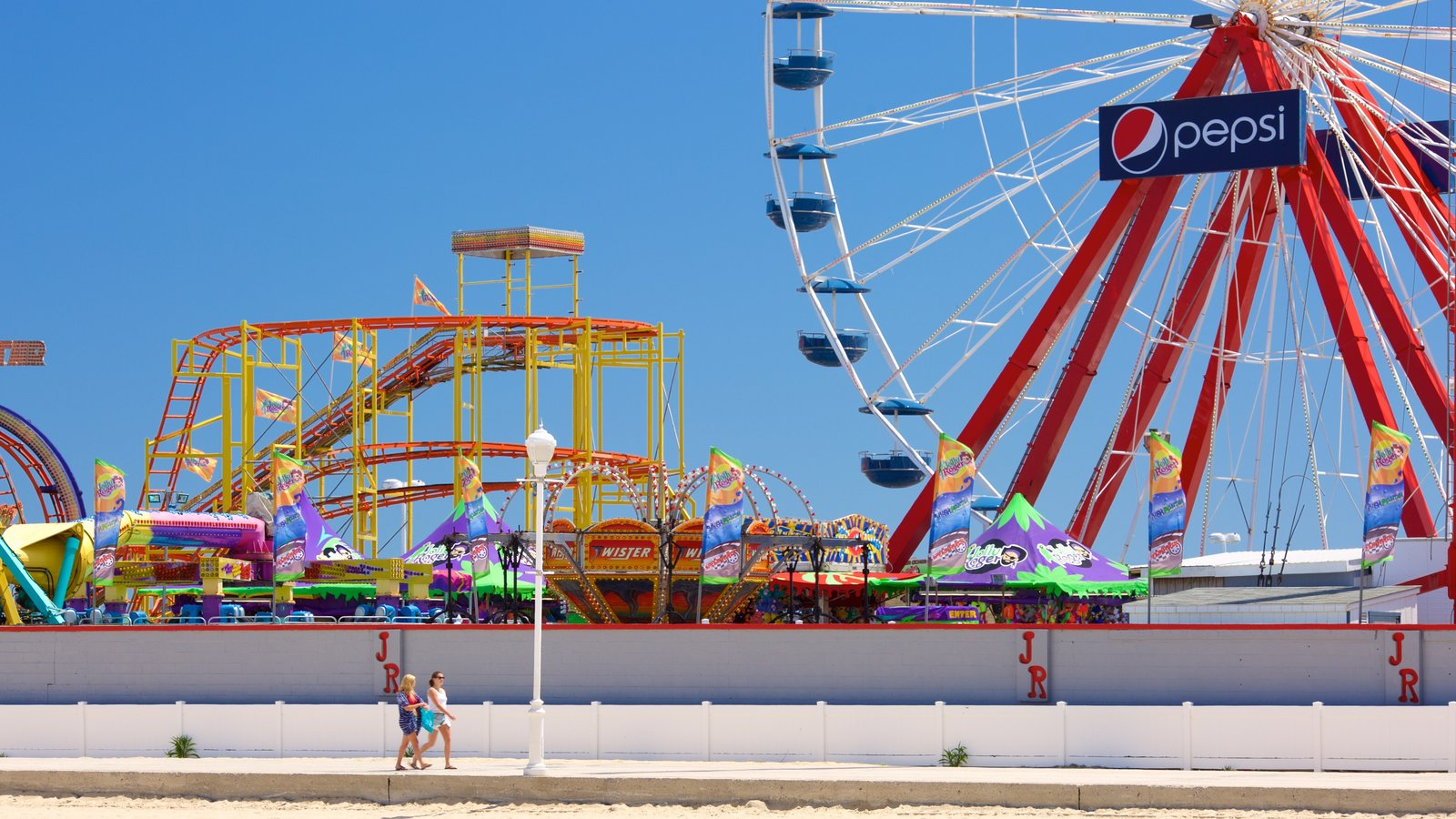 Ocean City Boardwalk featuring rides
