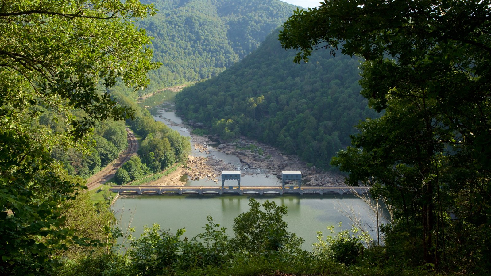 Hawks Nest State Park featuring a bridge, tranquil scenes and a river or creek