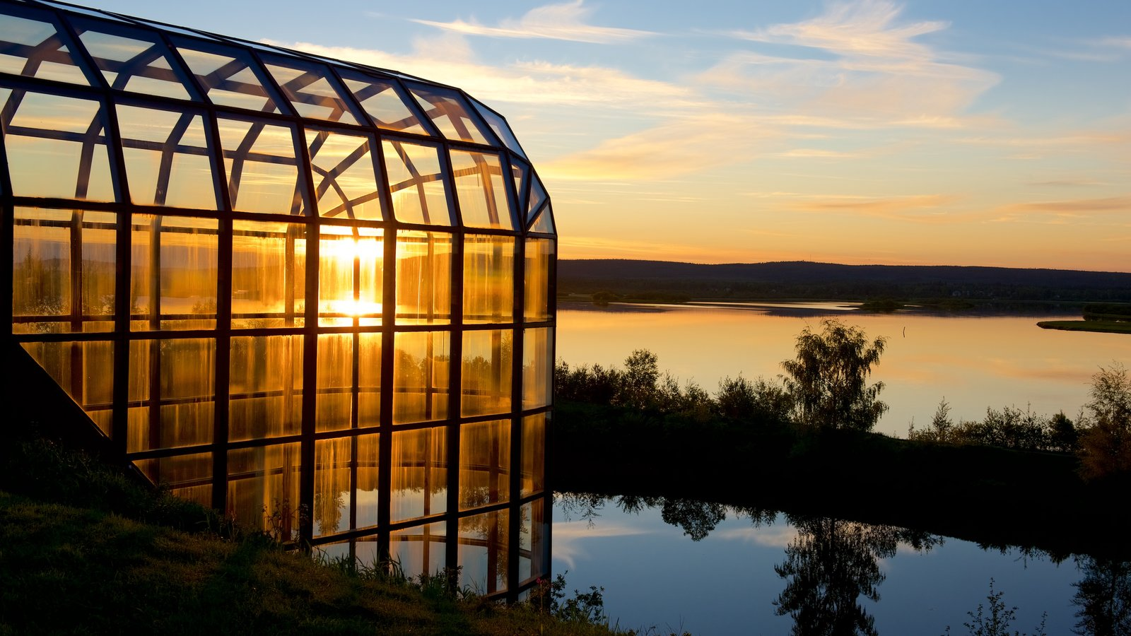 Arktikum featuring a sunset, tranquil scenes and a river or creek