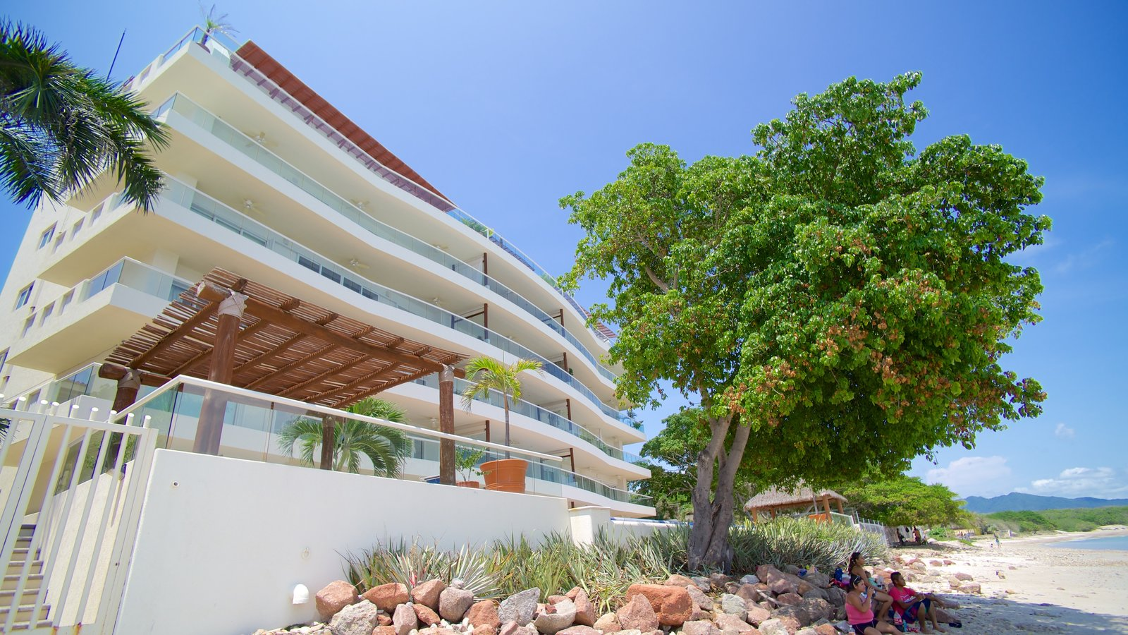 Punta Mita showing a beach and a luxury hotel or resort as well as a family