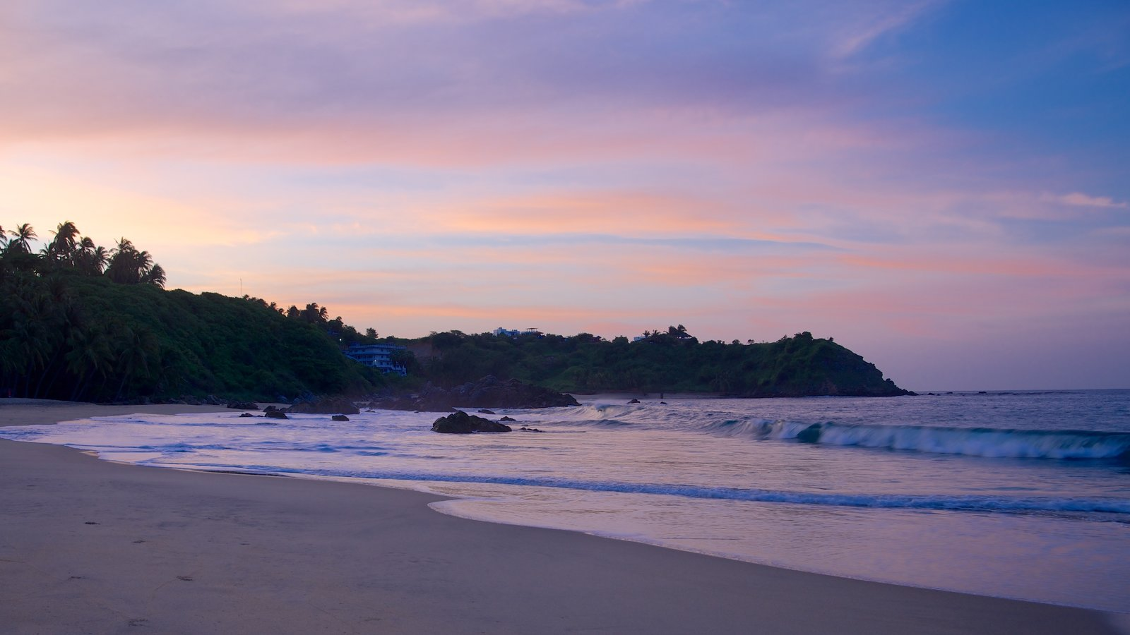 Bacocho Beach featuring rugged coastline, a beach and a sunset