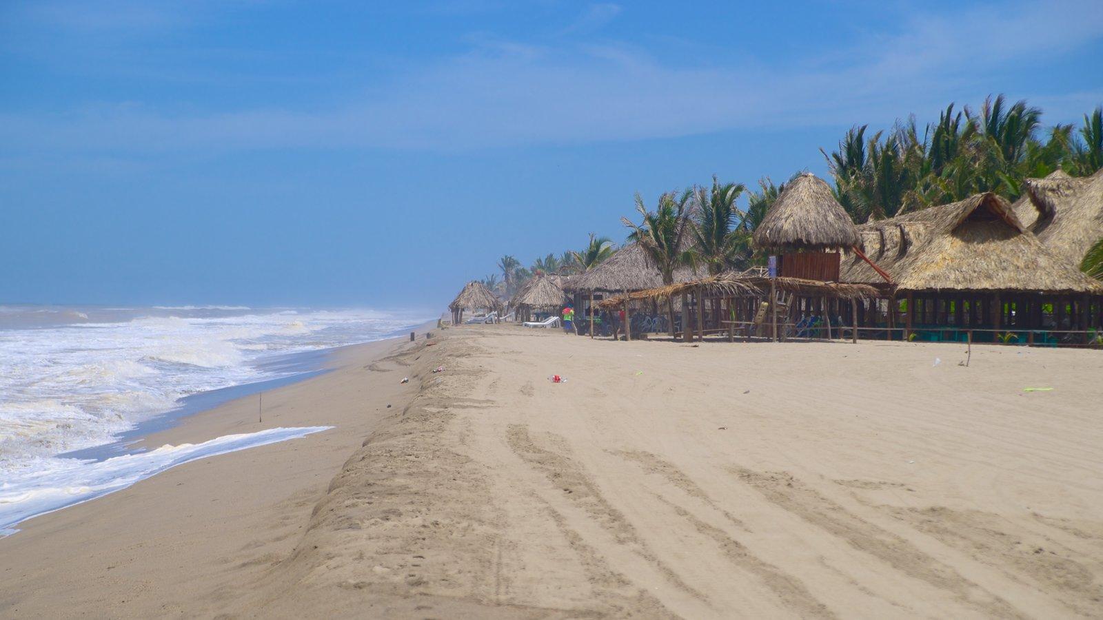 Playa De Barra Vieja Showing A Coastal Town And Sandy Beach
