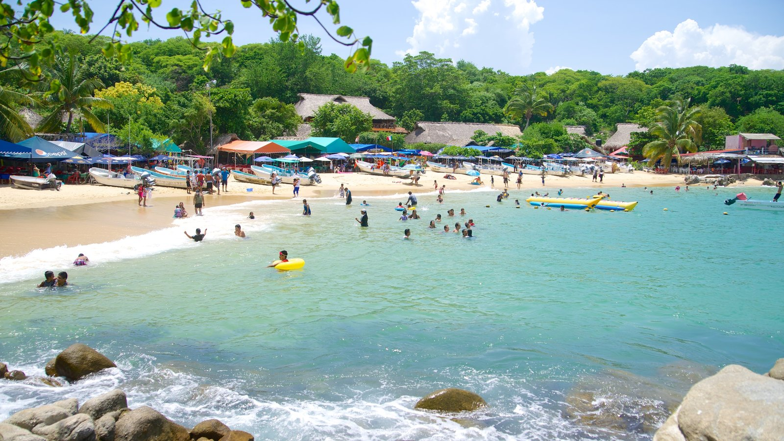 Puerto Angelito Beach showing a sandy beach and swimming