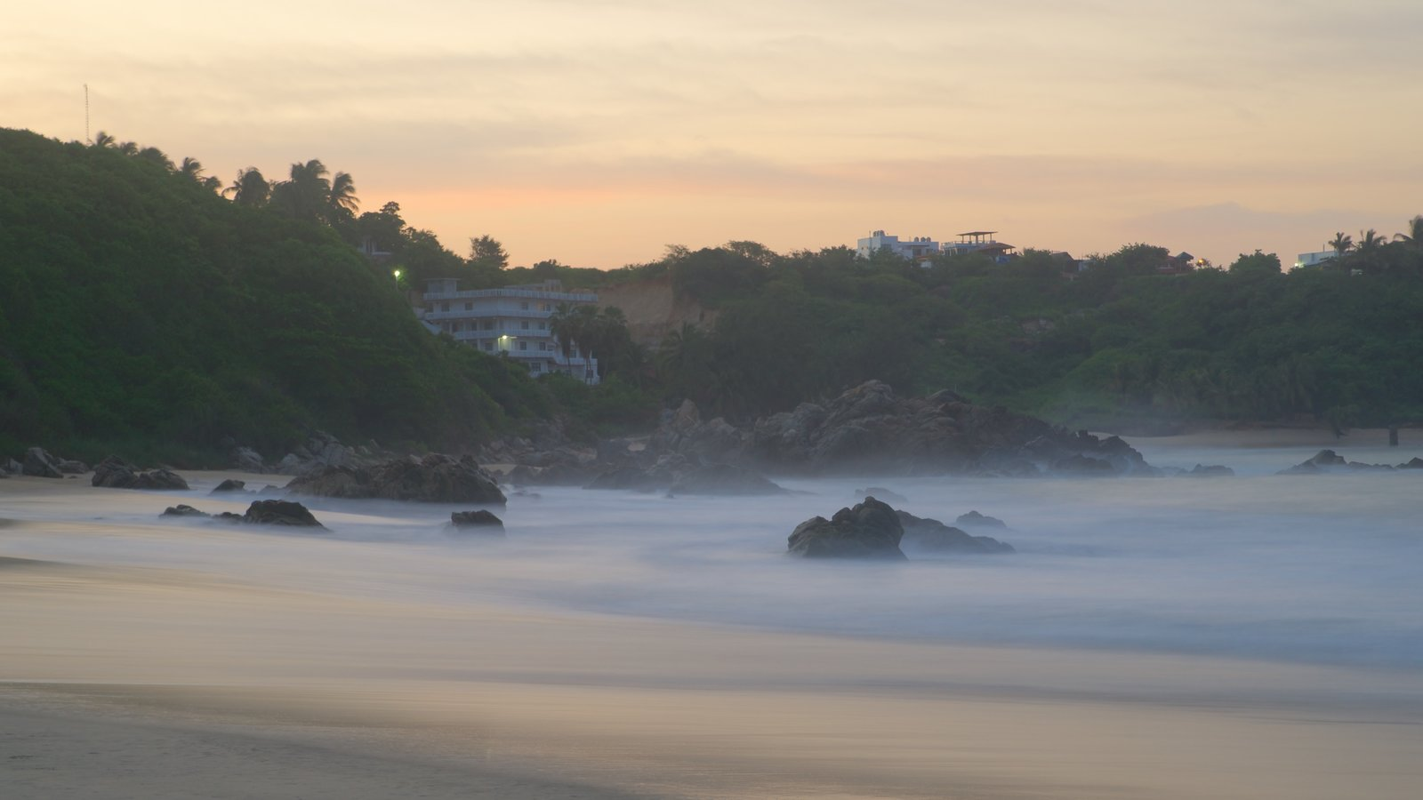 Bacocho Beach featuring a sunset, rocky coastline and a beach