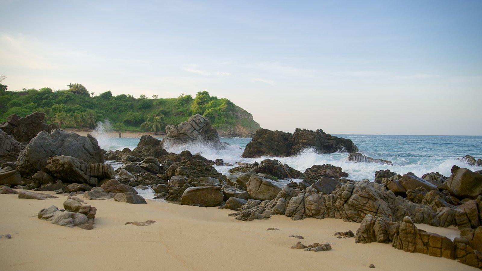 Bacocho Beach featuring a sandy beach and rugged coastline