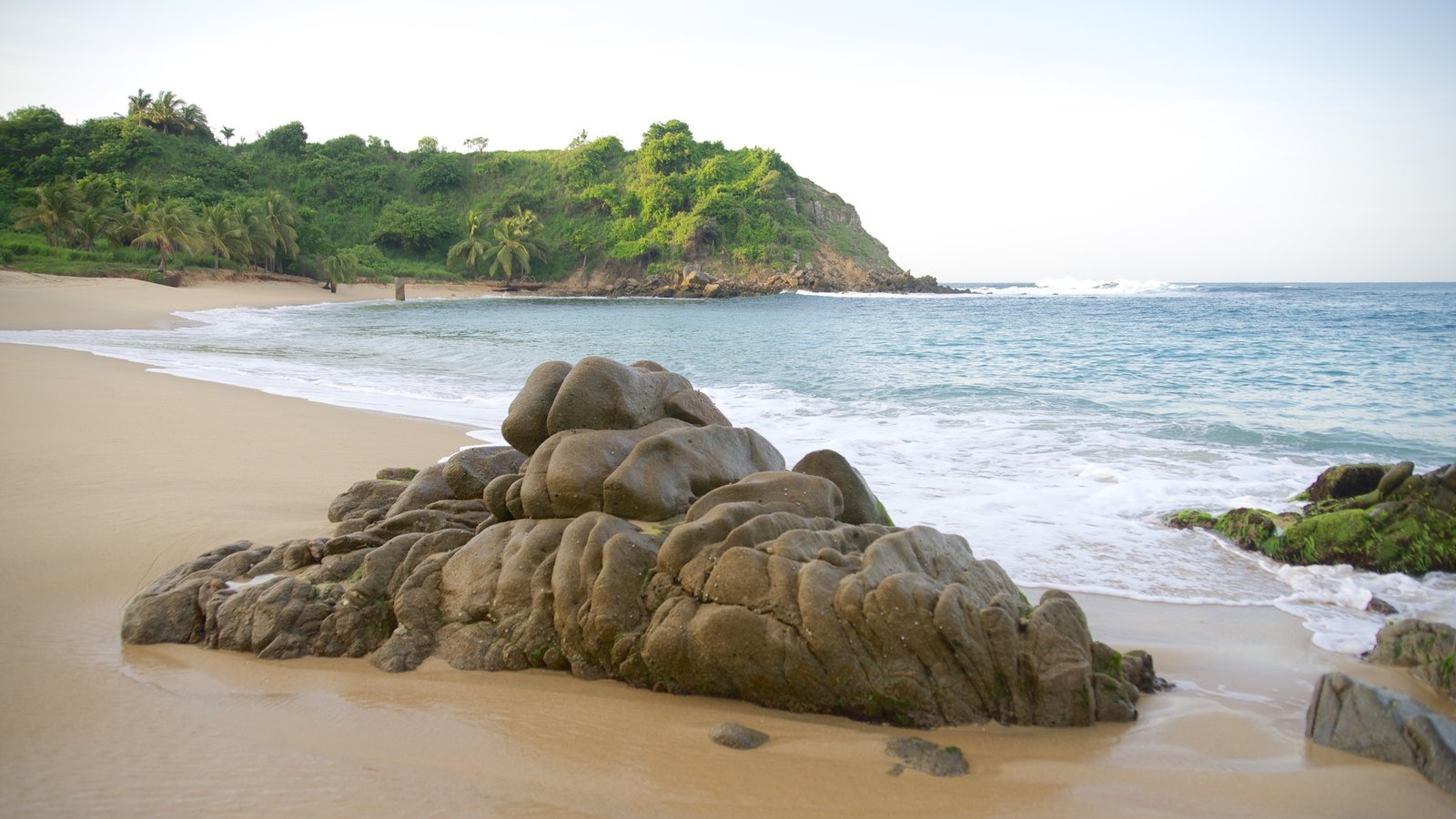 Bacocho Beach featuring rocky coastline and a sandy beach