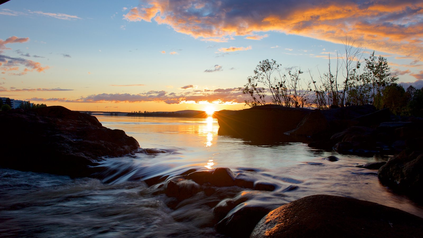 Finland featuring a sunset and a lake or waterhole