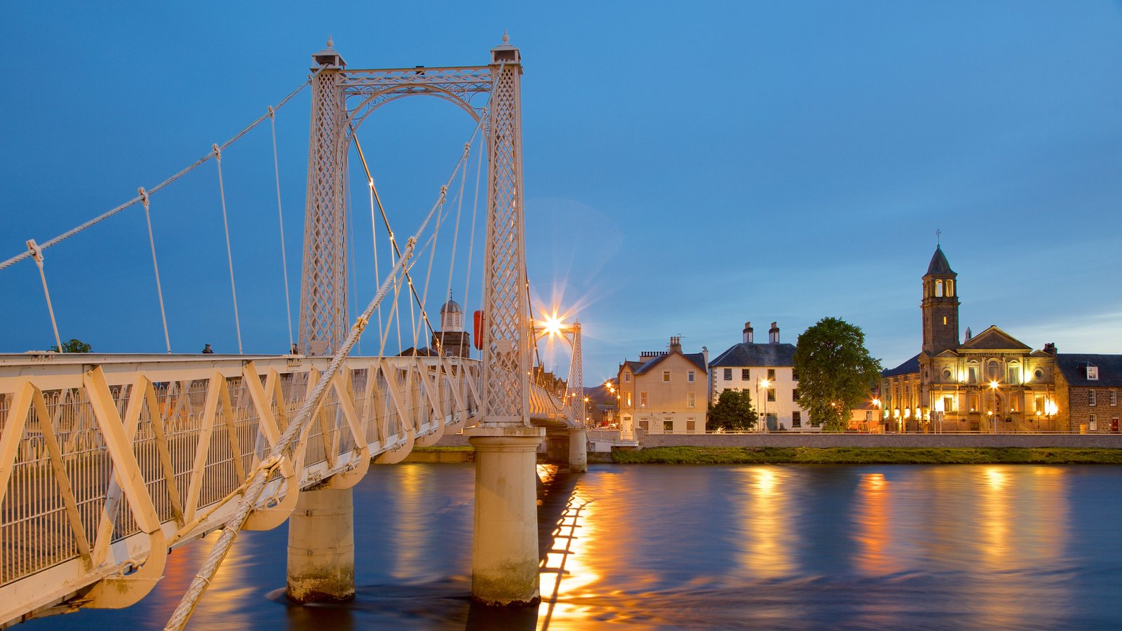 Inverness showing a river or creek, night scenes and a bridge