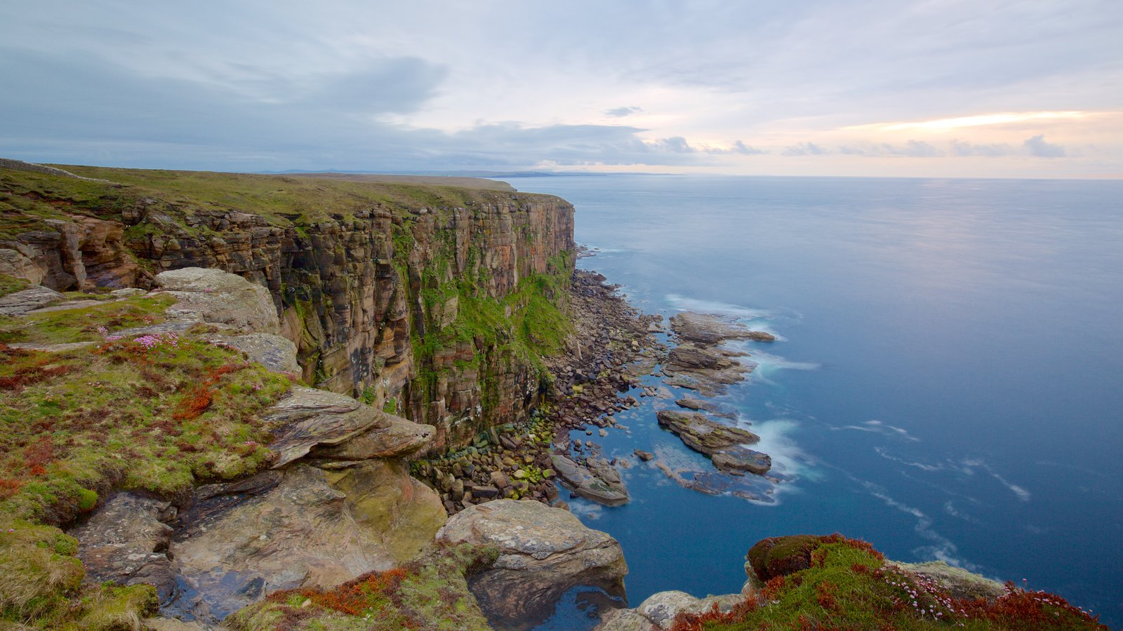 Dunnet Head Lighthouse showing rugged coastline