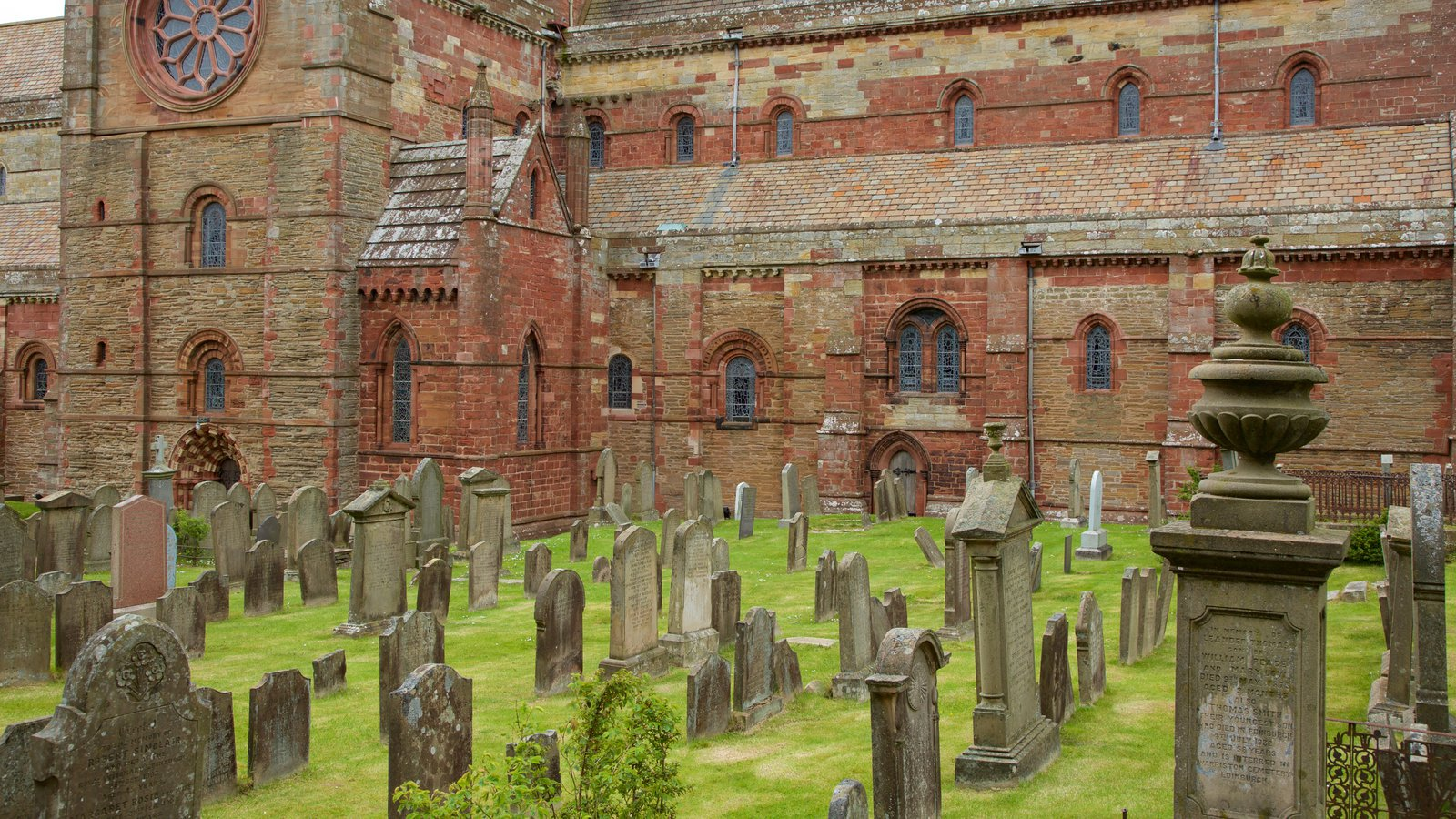 St. Magnus Cathedral featuring a cemetery, heritage elements and heritage architecture