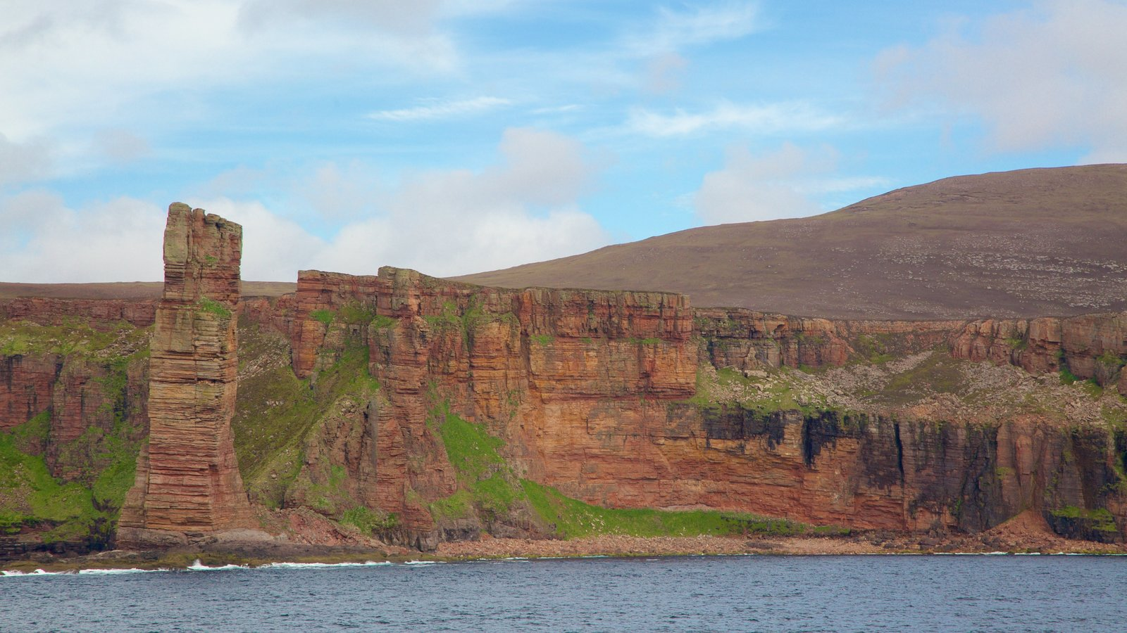 Old Man of Hoy which includes rugged coastline
