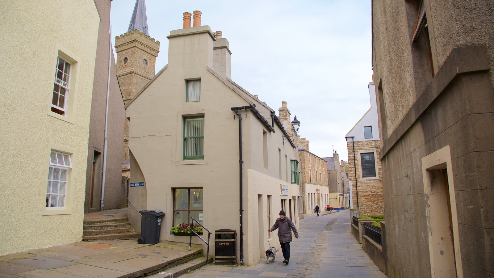 Stromness showing street scenes as well as an individual male