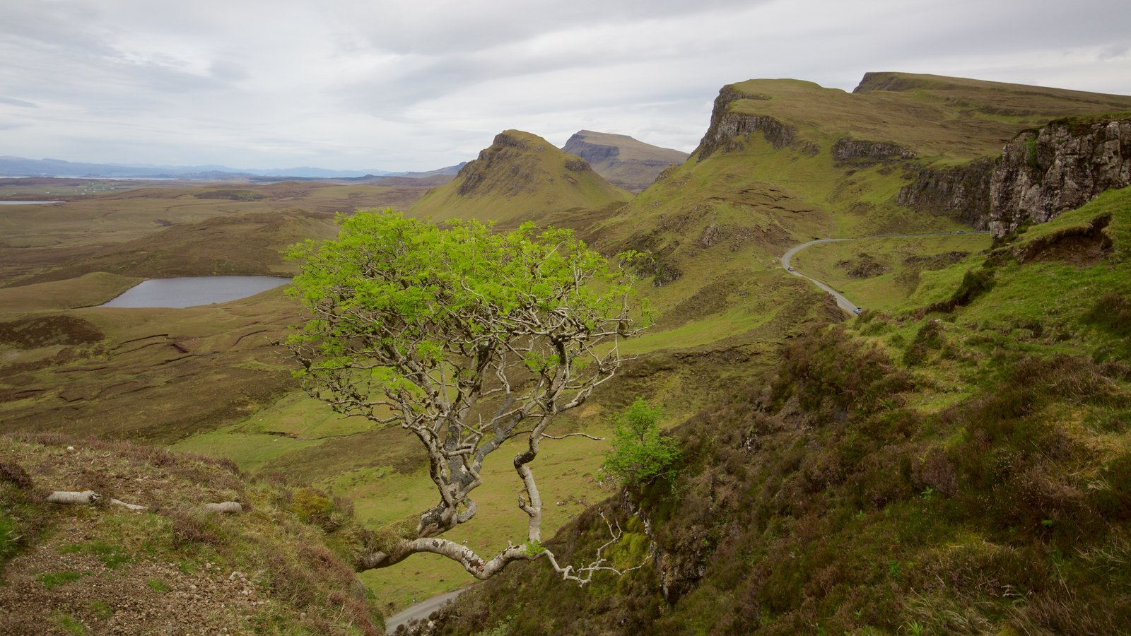Quiraing which includes mountains and tranquil scenes