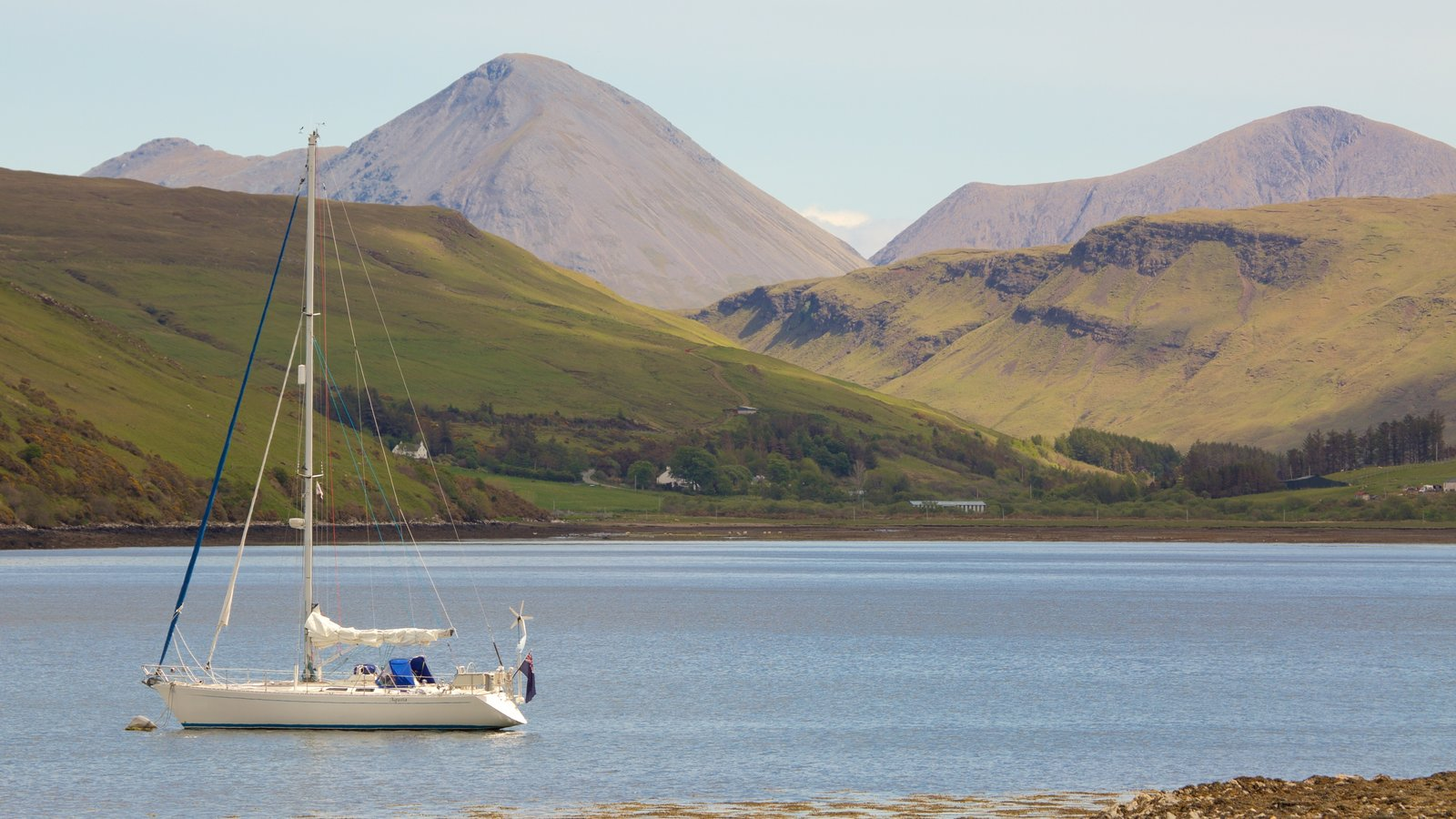Talisker Distillery which includes mountains, sailing and general coastal views