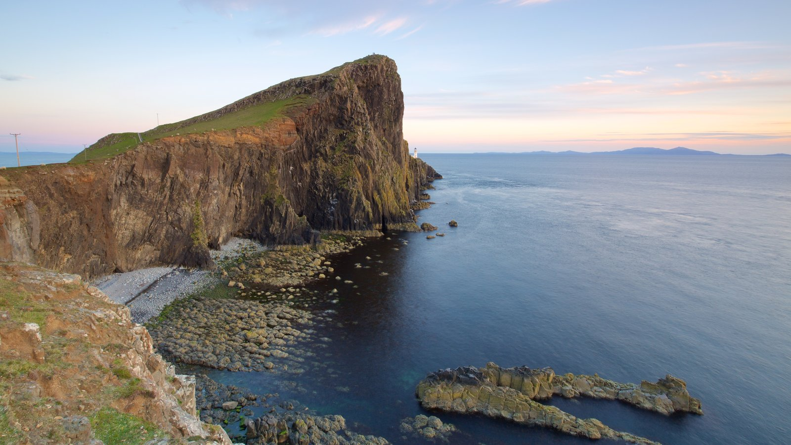 Isle of Skye featuring rugged coastline, mountains and a lighthouse