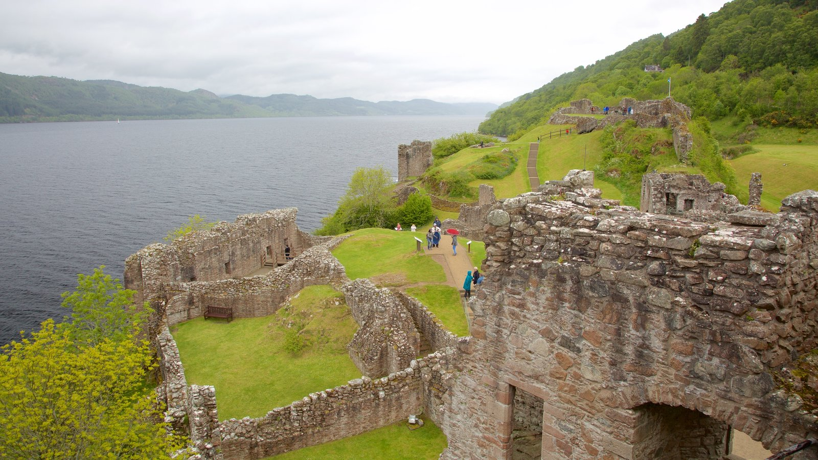 Urquhart Castle which includes chateau or palace, heritage elements and building ruins
