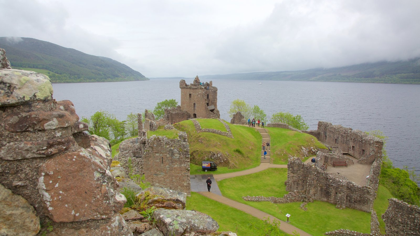Urquhart Castle which includes building ruins, a lake or waterhole and heritage elements