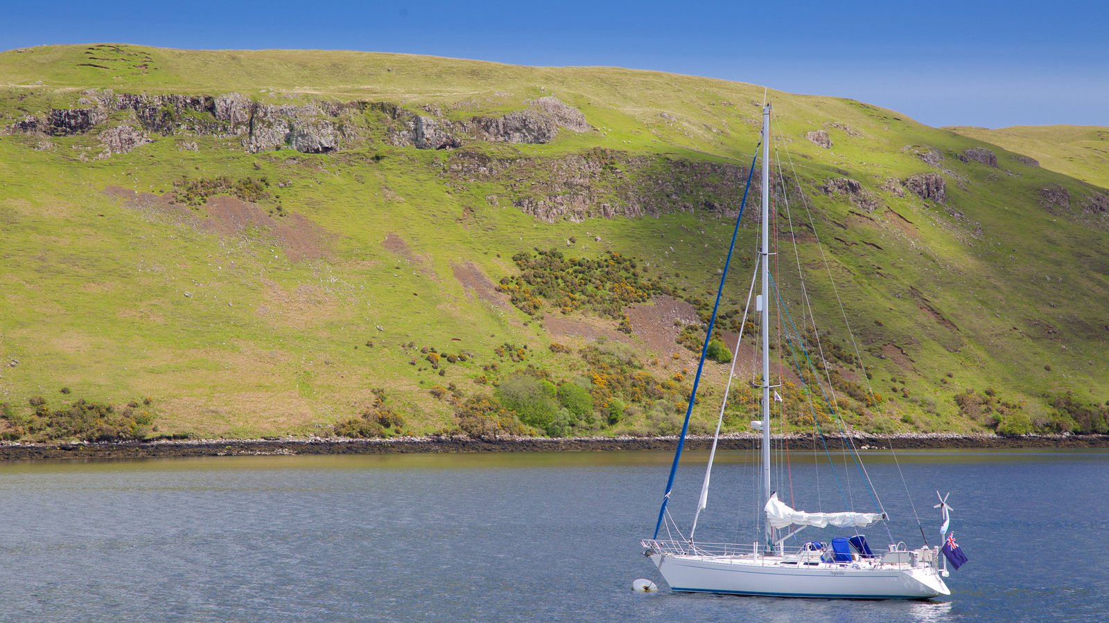 Talisker Distillery featuring sailing, tranquil scenes and a lake or waterhole