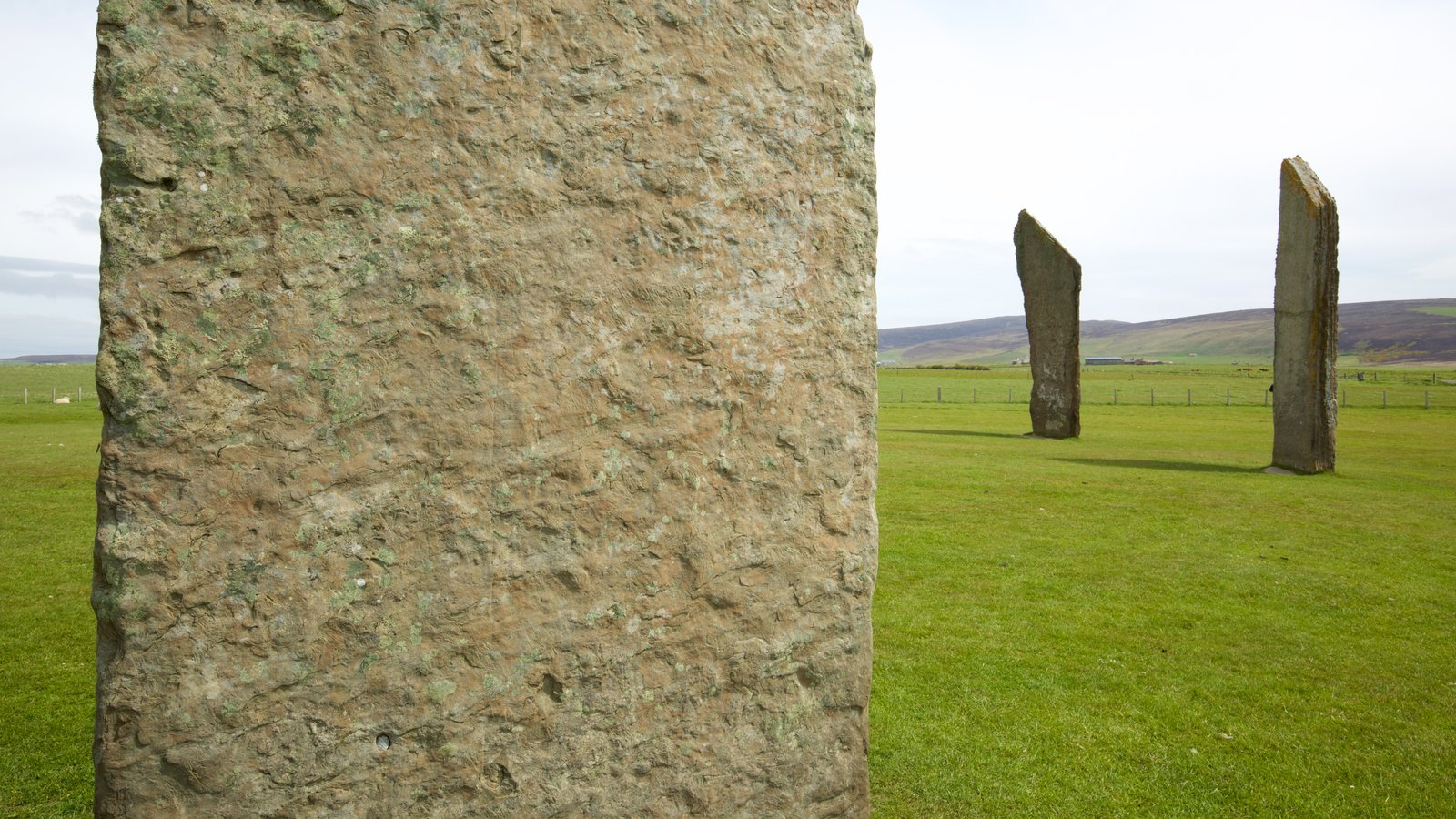Standing Stones of Stenness which includes heritage elements, tranquil scenes and a monument