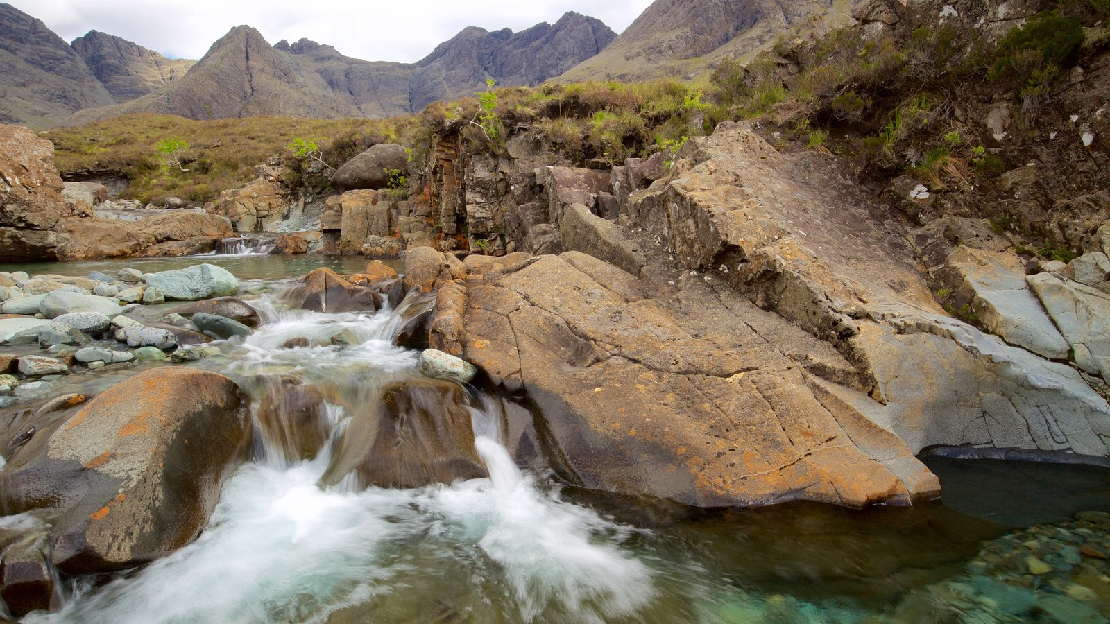 Isle of Skye featuring mountains, a river or creek and tranquil scenes