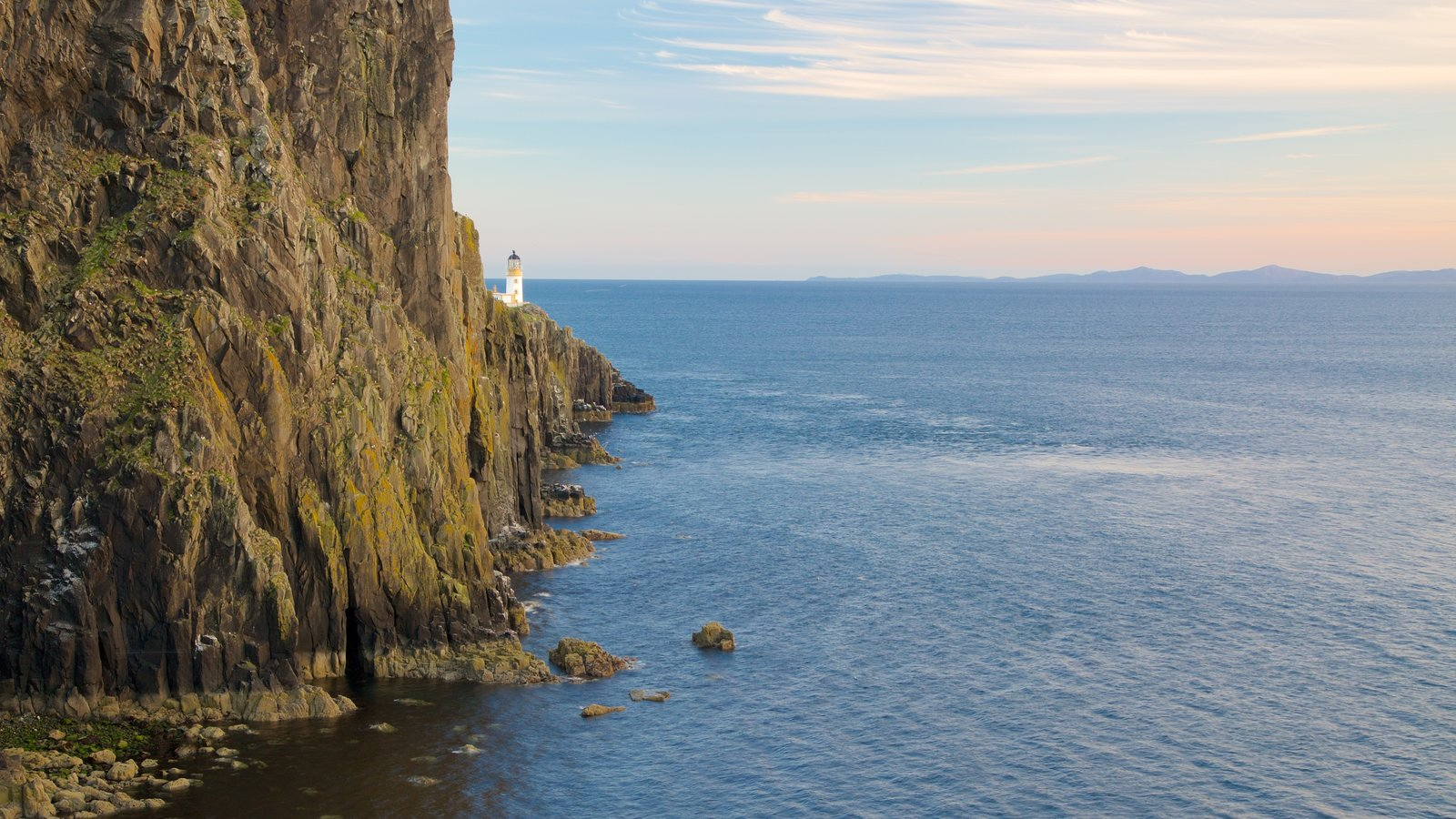 Isle of Skye which includes a lighthouse and rugged coastline