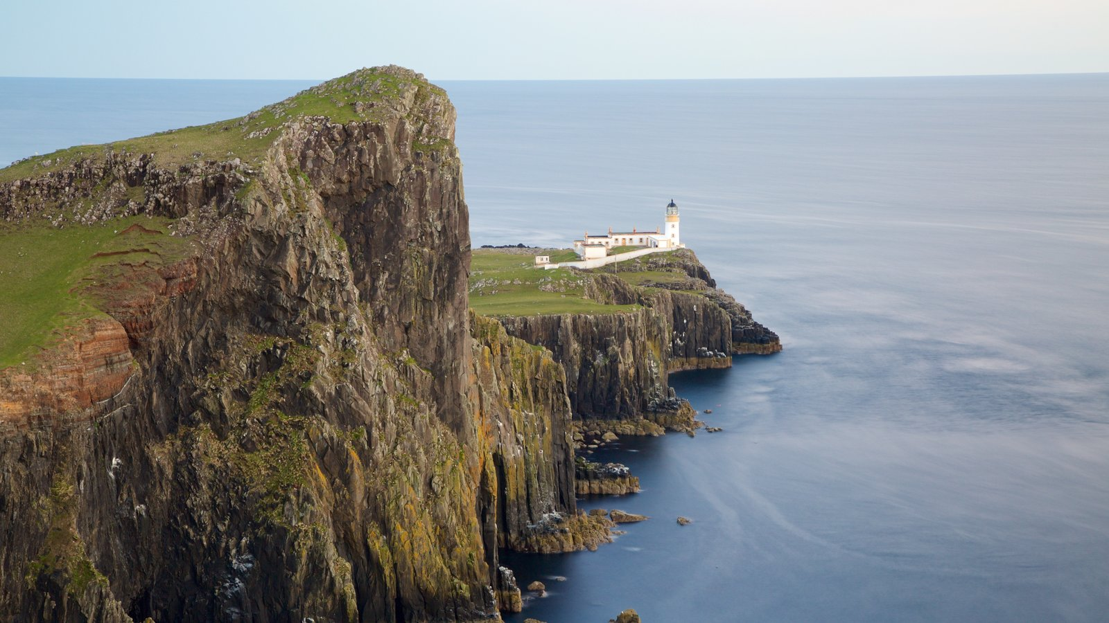 Isle of Skye showing rocky coastline and a lighthouse