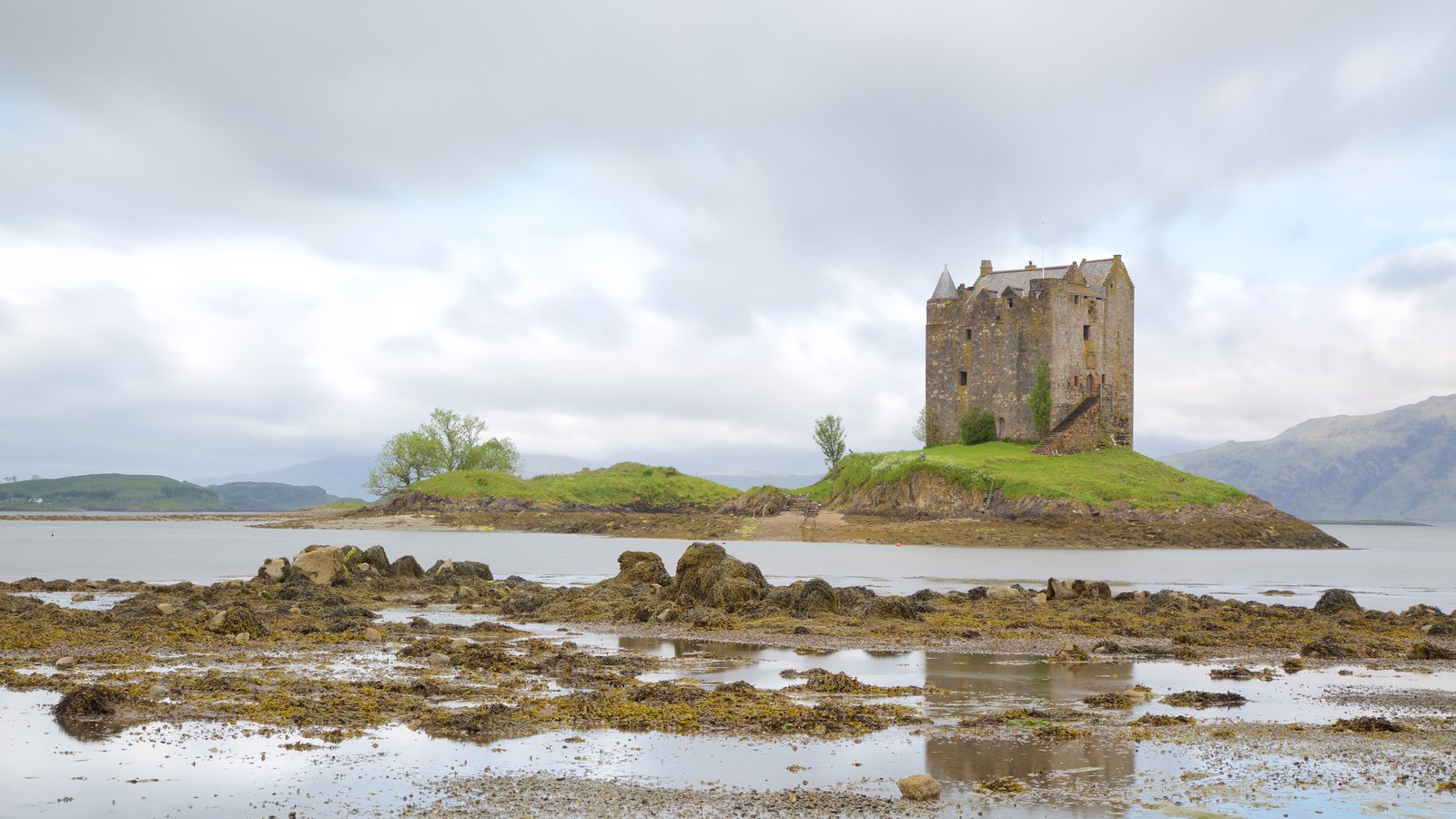 Castle Stalker featuring heritage elements, a lake or waterhole and heritage architecture